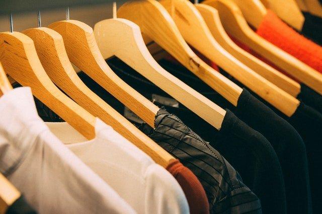 wooden hangers in wardrobe